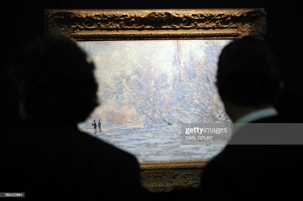 Visitors view a work entitled 'Le Givre a Giverny' by French artist Claude Monet at Sotheby's auction house in central London on January 31, 2013. Due to form part of the Impressionist and Modern Art Evening Sale on February 5, it is expected to fetch between 4-6 million GBP (5-7 million EUR - 6-10 million USD). AFP PHOTO / CARL COURT
