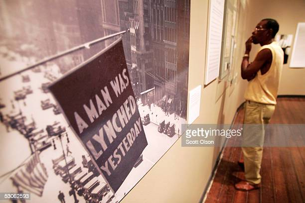 Visitors view an exhibit about lynching at the Chicago Historical Society June 13 2005 in Chicago Illinois The 'Without Sanctuary' exhibit features a...