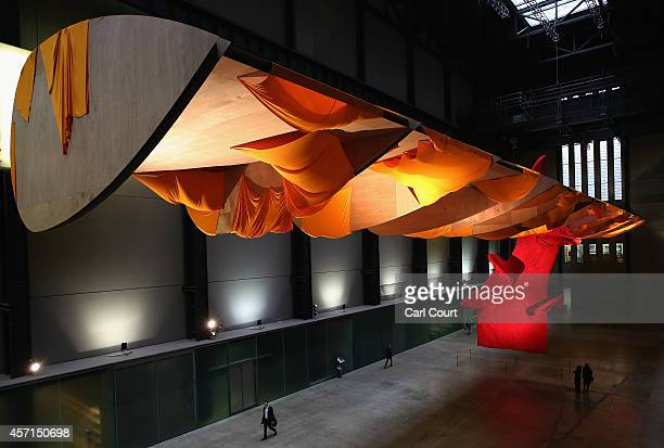 Visitors view an installation by US artist Richard Tuttle entitled 'I Don't Know The Weave Of Textile Language' in the Turbine Hall of the Tate...