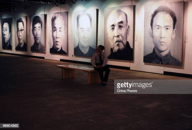Visitors view artworks at the 'Figures Xu Weixin Painting Art Exhibition' at the Wuhan Art Museum on May 2 2010 in Wuhan of Hubei Province China Xu...