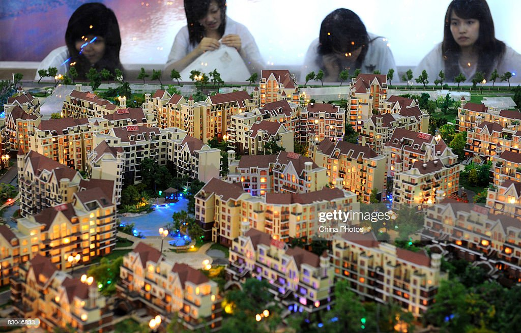 Visitors view building models at the 32nd Chengdu Real Estate Trade Fair on September 29, 2008 in Chengdu of Sichuan Province, China. Building structure and earthquake resistance has been highly concerned in property trading in Chengdu since the May 12 earthquake.