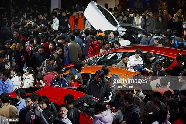 Visitors view cars at the Ford pavilion at the 2006 International Automotive Exhibition on November 25 2006 in Beijing China The week long exhibition...