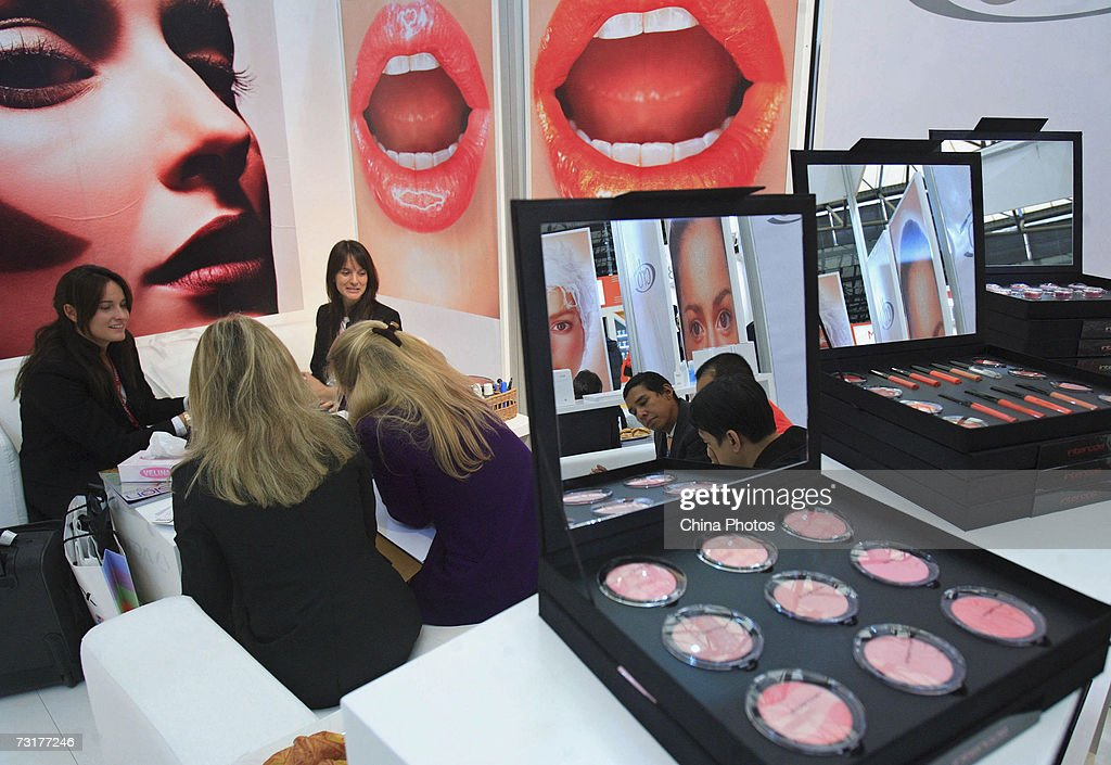 Visitors view cosmetic products at the Cosmoprof Shanghai exhibition on February 1, 2007 in Shanghai, China. Over 300 exhibitors from 23 countries and regions attended the event held from January 31 to February 3, during which about 100 new international brands debut on the Chinese market. Cosmoprof, the world's largest beauty trade show, was first found in Bologna of Italy in 1967 and later extended its network to Europe, North America and Asia, according to local media.