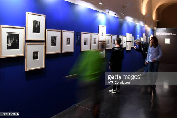 Visitors view etchings by late Dutch painter and printmaker Rembrandt during an exhibition of a complete collection of 68 original etchings at the...