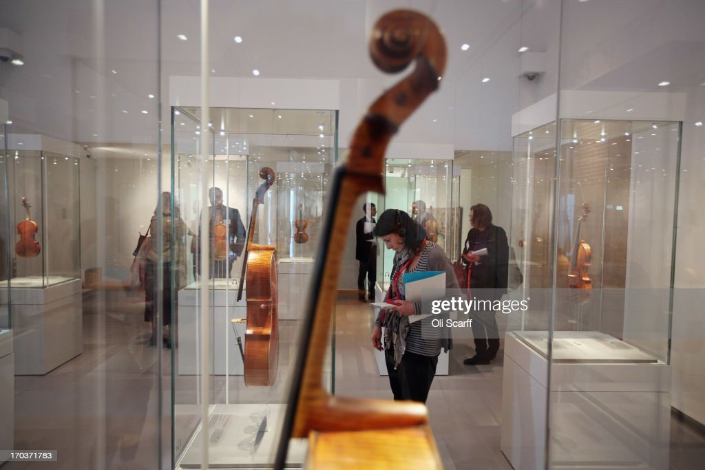 Visitors view instruments made by Antonio Stradivari on display in the exhibition 'Stradivarius' at the Ashmolean museum on June 12, 2013 in Oxford, England. The exhibition, which is the first major show of Stradivarius instruments in the UK, brings together 21 violins and cellos and runs until August 11, 2013.