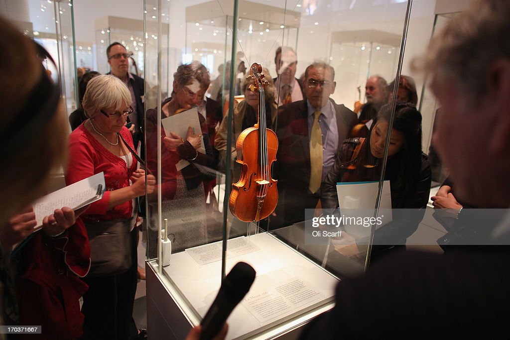 Visitors view 'Le Messie' violin made by Antonio Stradivari in 1716 on show at the exhibition 'Stradivarius' at the Ashmolean museum on June 12, 2013 in Oxford, England. The exhibition, which is the first major show of Stradivarius instruments in the UK, brings together 21 violins and cellos and runs until August 11, 2013.