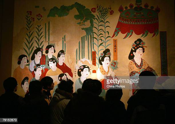 Visitors view replica of parts of the Mogao Cave during the Dunhuang Art Exhibition at the National Art Museum of China on January 21 2008 in Beijing...