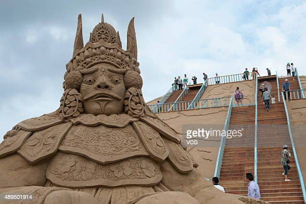 Visitors view sand sculptures at Zhujiajian Town in Putuo District on Septemebr 21 2015 in Zhoushan Zhejiang Province of China All those sand...