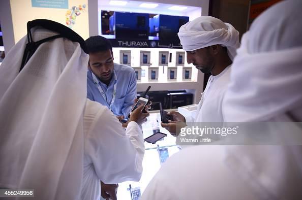 Visitors view satellite phones during the Abu Dhabi 2014 International Hunting Equestrian Exhibition on September 11 2014 in Abu Dhabi United Arab...