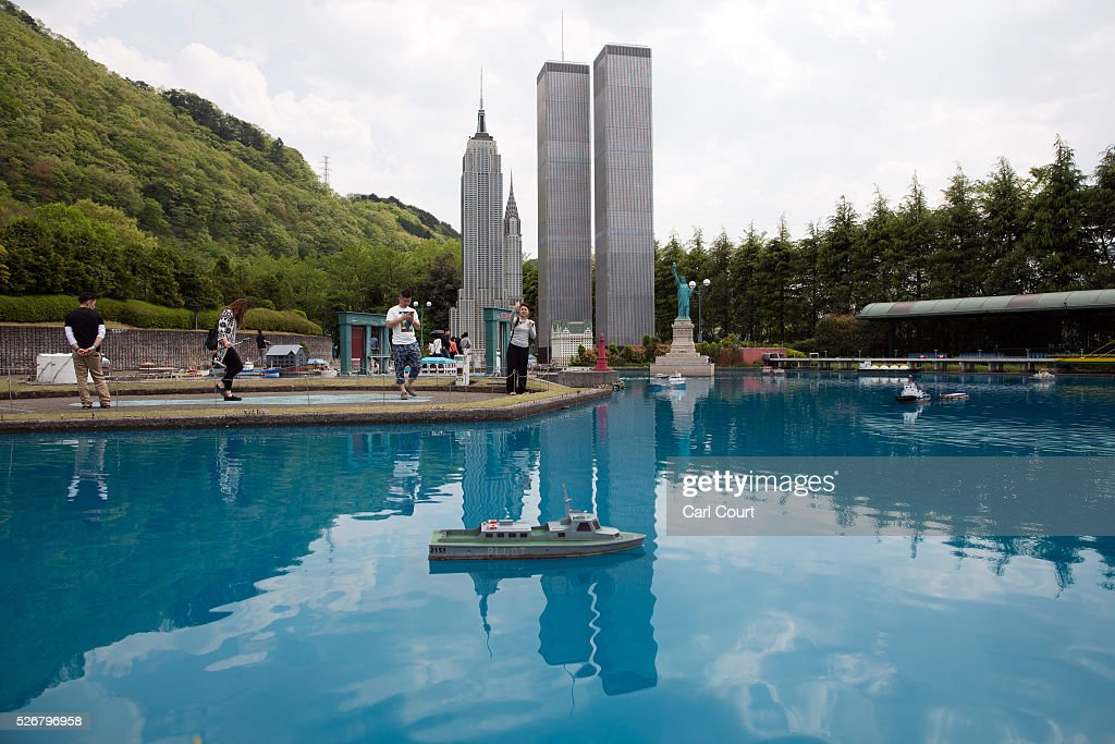 Visitors view scale models of the World Trade Center and the Empire State Building at Tobu World Square theme park on May 01, 2016 in Nikko, Japan. Tobu World Square contains over a hundred 1:25 scale models of famous buildings, including World Heritage Sites, complete with 140,000 1:25 miniature people and receives visitors from around the world.