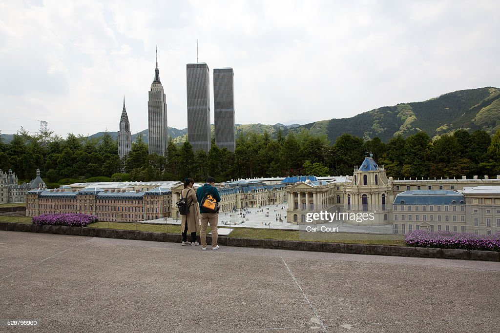 Visitors view scale models of Versailles Palace, the World Trade Center and Empire State Building at Tobu World Square theme park on May 01, 2016 in Nikko, Japan. Tobu World Square contains over a hundred 1:25 scale models of famous buildings, including World Heritage Sites, complete with 140,000 1:25 miniature people and receives visitors from around the world.