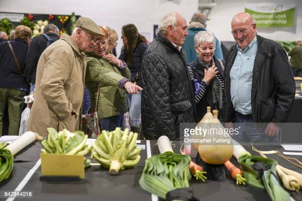 Visitors view some of the prize winning vegetables on show at the Harrogate Autumn Flower Show on September 15 2017 in Harrogate England Gardeners...