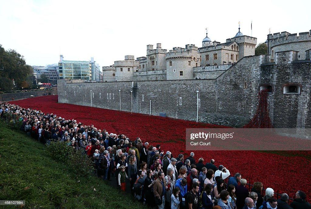 Visitors view the 'Blood Swept Lands and Seas of Red' installation at Tower of London on October 30 2014 in London England The installation by...