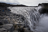 Visitors view the Dettifoss waterfall in Northeast Iceland on September 8 2014 in Iceland The waterfall location was featured in Ridley Scott's 2012...