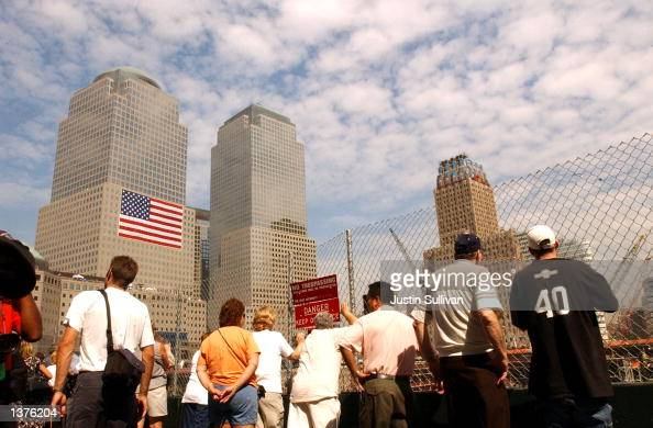 Visitors view the Ground Zero site September 10 2002 in New York City Work continues at Ground Zero in preparation for the one year anniversary...
