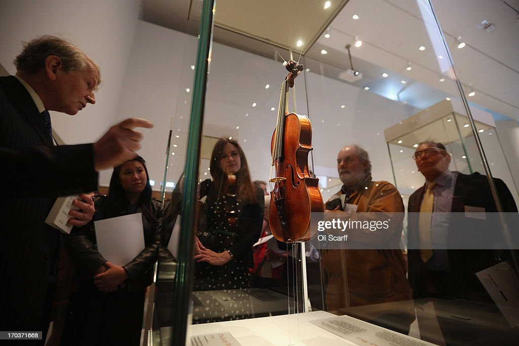 Visitors view 'The Lady Blunt' violin made by Antonio Stradivari in 1721 on show at the exhibition 'Stradivarius' at the Ashmolean museum on June 12, 2013 in Oxford, England. The exhibition, which is the first major show of Stradivarius instruments in the UK, brings together 21 violins and cellos and runs until August 11, 2013.