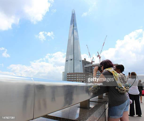 Visitors view the newly completed exterior of the Shard from London Bridge on July 5 2012 in London England The European Union's highest building...