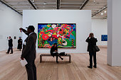 Visitors view works of art during a preview for media and guests at the new Whitney Museum of American Art in New York US on Thursday April 23 2015...