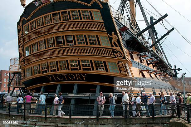 Visitors viewing HMS Victory in Portsmouth Historic Dockyard UK