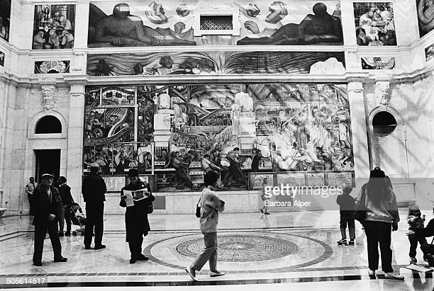Visitors viewing one of the Detroit Industry Murals a series of frescoes by Mexican painter Diego Rivera at the Detroit Institute of Arts Detroit...