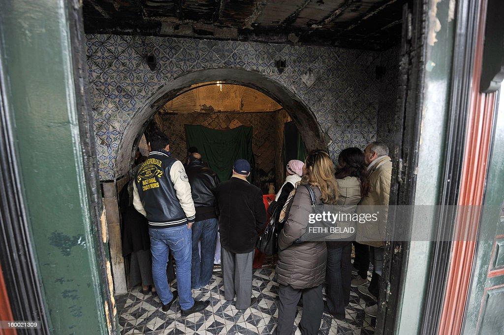 Visitors visit the Sidi Bou Said mausoleum in Tunisia on January 24, 2013. The renovation project of the recently torched mausoleum is mid-way through, as it was prepared for a modest reopening to welcome visitors commemorating the birth of Prophet Mohammed, known in Arabic as 'al-Mawlid al-Nabawi'. In the 35th such attack in seven months, unidentified assailants hurled Molotov cocktails at the Sidi Ahmed Uwerfelli shrine in Akuda, 140 kilometres (85 miles) south of Tunis.