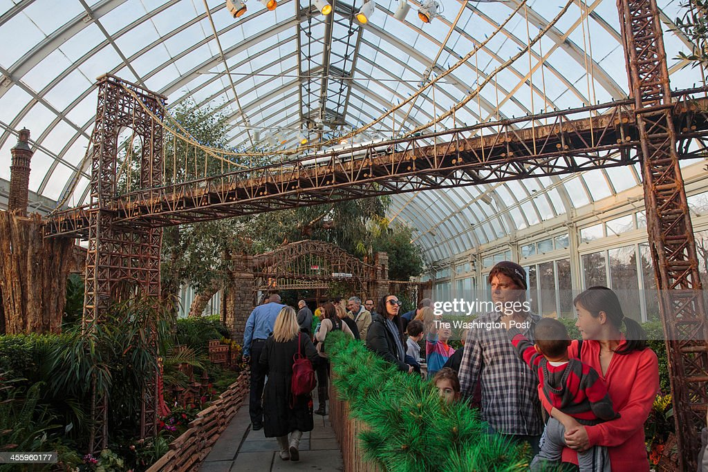 Visitors wait expectantly at the 22nd Annual Holiday Train Show in the New York Botanical Garden on Sunday December 1 2013 The exhibition showcases...