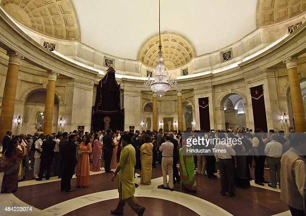Visitors wait for the President Pranab Mukherjee and Prime Minister Narendra Modi to arrive for the general public meeting during 'At Home' reception...
