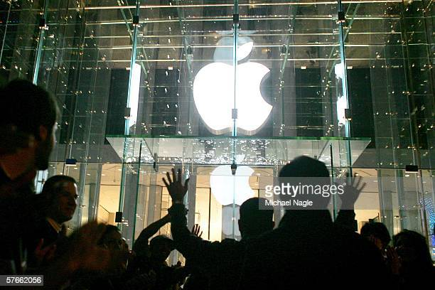 Visitors wait in line to enter the new Apple Store on Fifth Avenue on May 19 2006 in New York City Apple plans to keep the store open 24 hours a day...