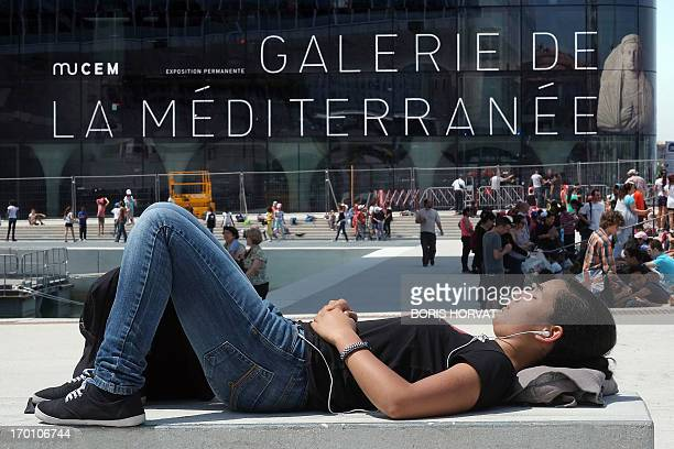 Visitors wait on June 7 2013 in Marseille southern France for the official opening of the Mucem thre days after its inauguration The event is part of...