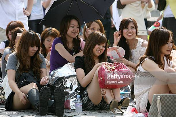 Visitors wait outside the venue for 'Tokyo Girls Collection 2008 A/W' at Yoyogi Gymnasium on September 6 2008 in Tokyo Japan The fashion show...