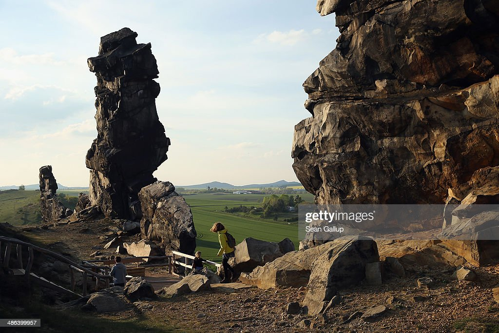 Visitors walk along a prominent portion of the Devil's Wall (Teufelsmauer), a natural rock formation in the Harz region, on April 20, 2014 near Weddersleben, Germany. The formation, which runs approximately 20km, is made of sandstone and was created through geological activity in the Late Cretaceous period.