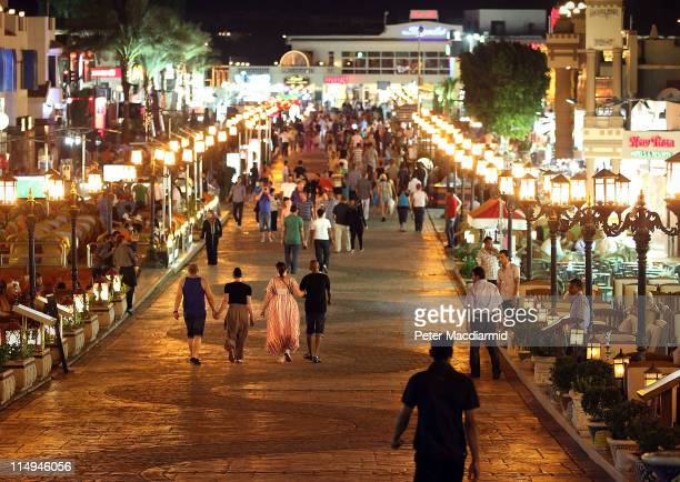 Visitors walk along a road containing bars and shops at night in Naama Bay on May 30 2011 in Sharm El Sheikh Egypt Protests in January and February...