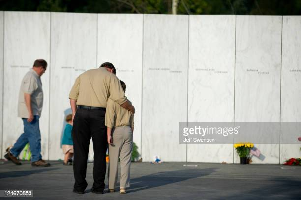 Visitors walk along the Wall of Names prior to the ceremony marking the 10th anniversary of the crash of United Flight 93 at the Flight 93 National...
