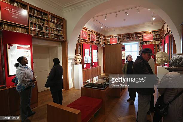 Visitors walk among busts of brothers Jacob and Wilhelm Grimm in the library at the Grimm Brothers Museum on November 20 2012 in Kassel GermanyThe...