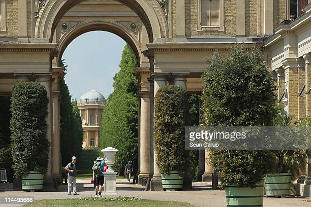 Visitors walk among exotic plants outside the Orangerie at Sanssouci Park on May 22 2011 in Potsdam Germany Every year workers wheel out the several...