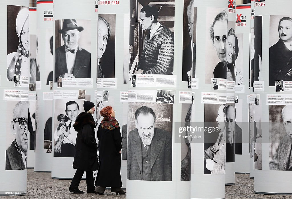 Visitors walk among portraits of Berlin Jews and political opponents persecuted, and in many cases murdered or driven to suicide, by the Nazis in the exhibition 'Diversity Destroyed' on January 30, 2013 in Berlin, Germany. The exhibition coincides with the 80th anniversary of the assumption of power by the Nazis with the appointment of Adolf Hitler as Reichskanzler, or Chancellor of the Empire.