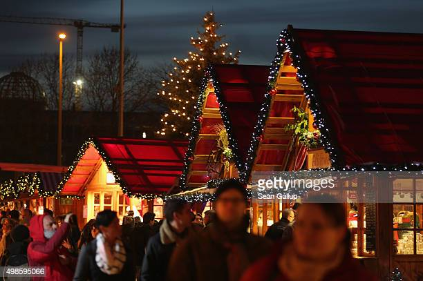 Visitors walk among stalls at the annual Christmas market at Alexanderplatz on November 24 2015 in Berlin Germany Christmas markets are opening...