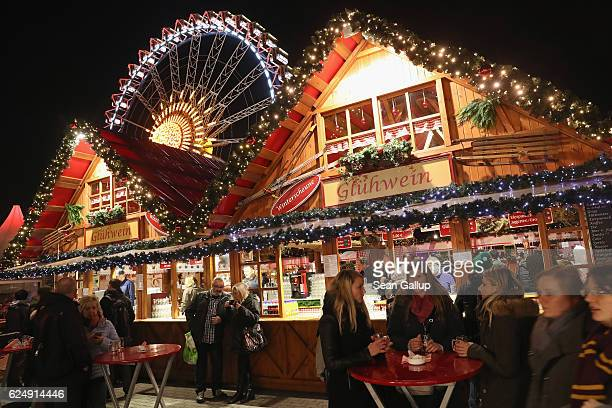 Visitors walk among stalls at the annual Christmas market at Alexanderplatz on the market's opening day on November 21 2016 in Berlin Germany...