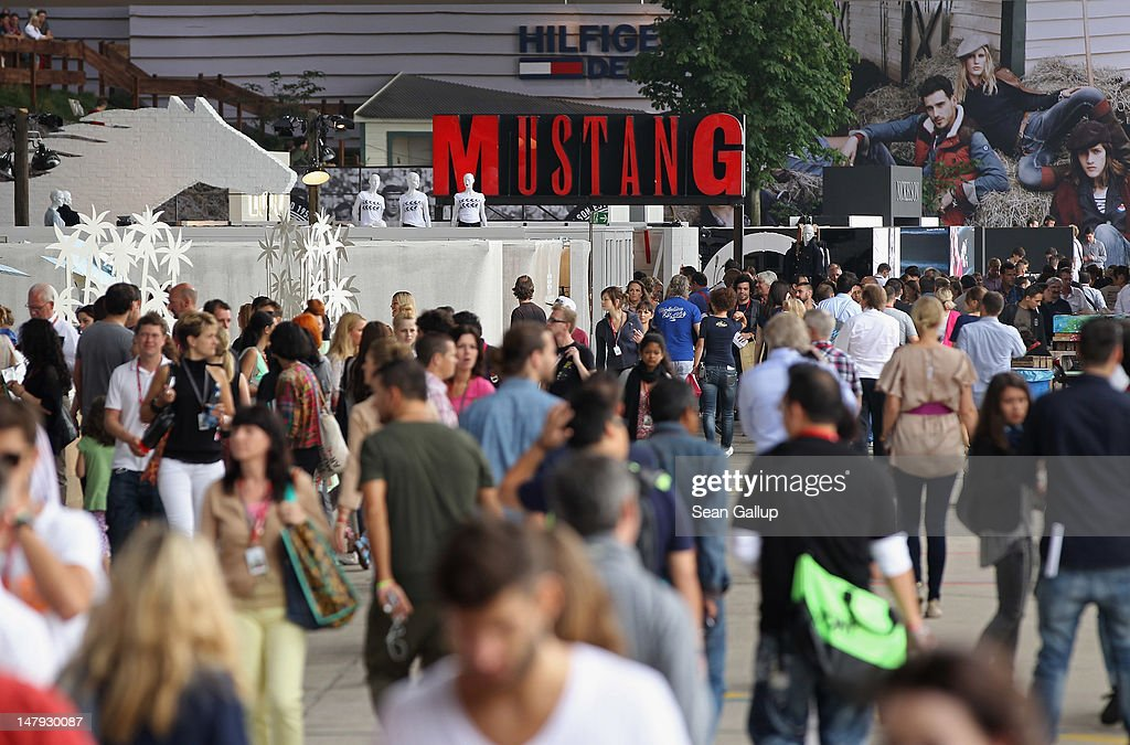 Visitors walk among stands in the Denim hall at the 2012 Bread & Butter fashion trade fair at former Tempelhof Airport on July 6, 2012 in Berlin, Germany. Bread & Butter is the world's largest trade fair for street fashion.