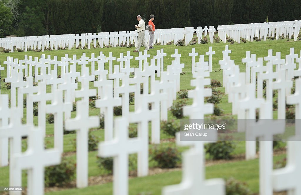 Visitors walk among the thousands of crosses marking the graves of French soldiers killed in the Battle of Verdun at the ossuary of Douaumont on May 27, 2016 in Verdun, France. The governments of France and Germany will commemorate the 100th anniversary of the battle with ceremonies this coming Sunday. Approximately 300,000 soldiers lost their lives in the 10-month campaign that was among the most grueling battles of the war.