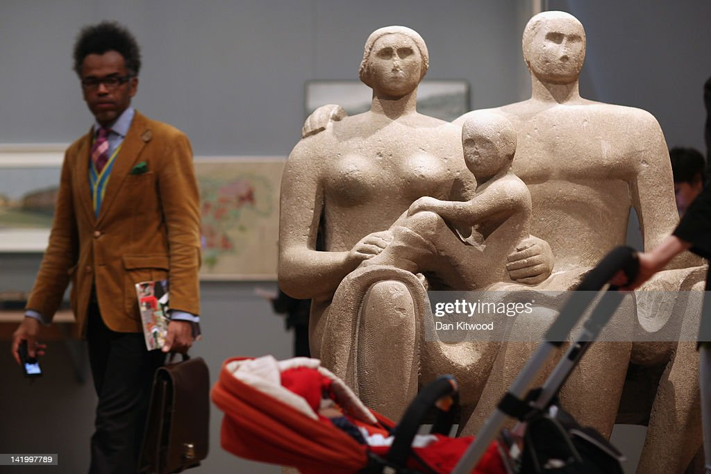 Visitors walk around a carving by British artist Henry Moore, entitled 'Family Group', at the Victoria and Albert museum's new major exhibition, 'British Design 1948-2012: Innovation In The Modern Age' on March 28, 2012 in London, England. The exhibition showcases some of the most iconic product design, fashion, furniture, graphics, architecture and fine art from the last 60 years, and opens to the public from March 31, 2012.