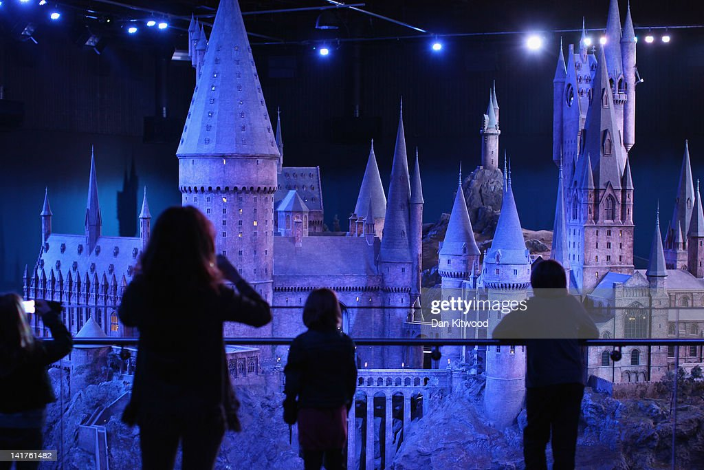 Visitors walk around a model of 'Hogwarts Castle' at the Harry Potter Studio Tour at Warner Brothers Leavesden Studios on March 23, 2012 in London, England. The studio, which includes the actual sets and special effects departments where the films were created and shot, goes on public display on March 31, 2012.