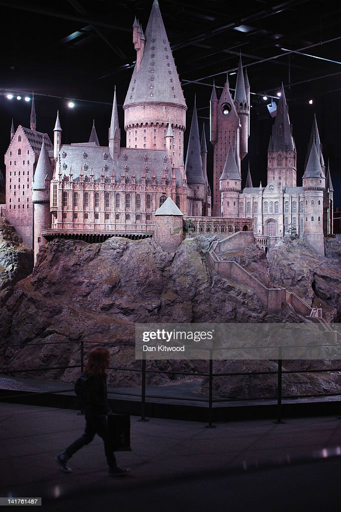 Visitors walk around a model of 'Hogwarts Castle' at the Harry Potter Studio Tour at Warner Brothers Leavesden Studios on March 23, 2012 in London, England. The studio includes the actual sets and special effects departments where the films were created and shot and goes on public display on March 31, 2012.