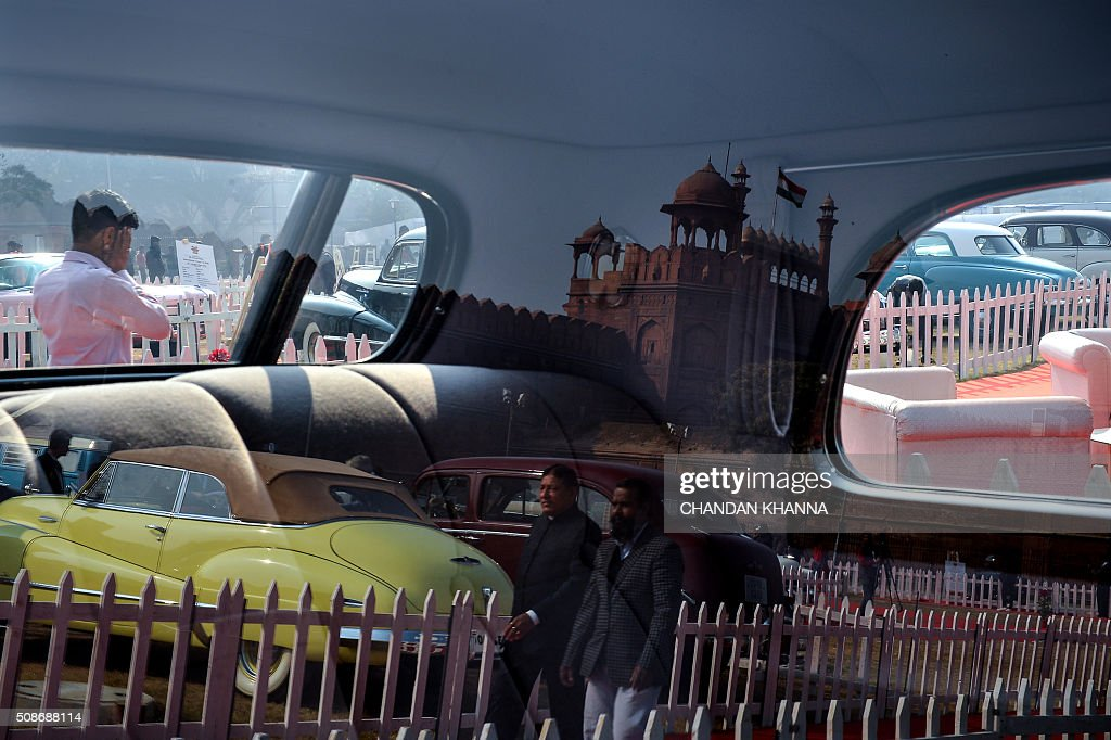Visitors walk around at the 6th 21 Gun Salute International Vintage Car Rally in New Delhi on February 6, 2016. The two event ends February 7. The two-day event ends February 7. AFP PHOTO / CHANDAN KHANNA / AFP / Chandan Khanna