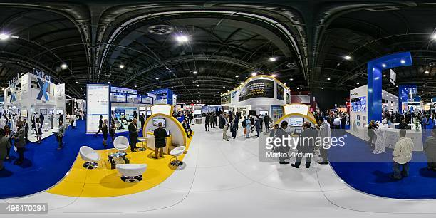 Visitors walk around company stands at the 35th GITEX Technology Week at Dubai World Trade Centre on October 20 2015 in Dubai United Arab Emirates...