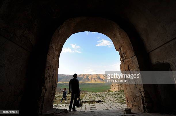 Visitors walk around Hasankeyf a small poverty stricken town on the banks of the Tigris on April 10 2010 Hasankeyf was once considered a mighty city...