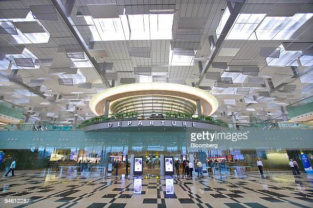 Visitors walk around the departure hall at Changi airport's new Terminal 3 in Singapore on Wednesday Jan 9 2008 Singapore's Changi airport opened a...