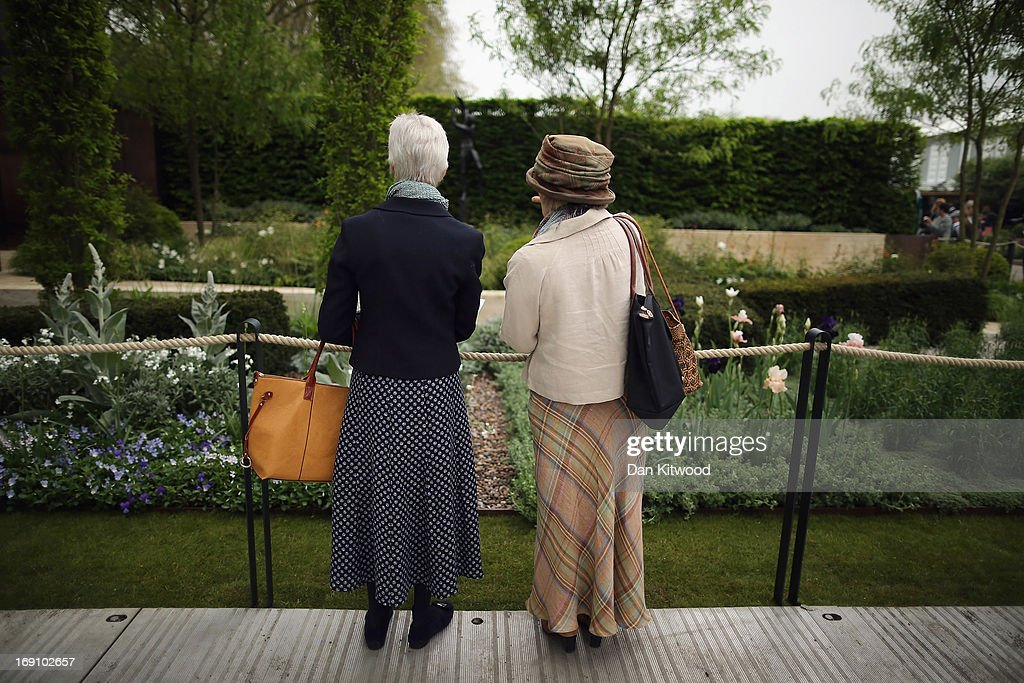 Visitors walk around the gardens during the Chelsea Flower Show on May 20, 2013 in London, England. The Chelsea Flower Show run by the RHS celebrates its 100th birthday this year.