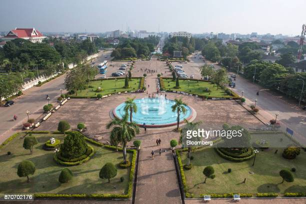 Visitors walk around the park at the Patuxai Victory monument in Vientiane Laos on Thursday Nov 2 2017 Located in the Mekong region Southeast Asia's...
