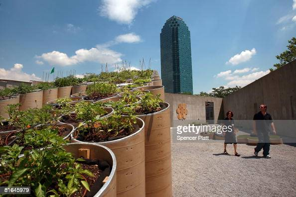 Visitors walk around the PS1 exhibition titled 'PF1 ' a new installation celebrating the theme of urban farming June 20 2008 in the Queens borough of...